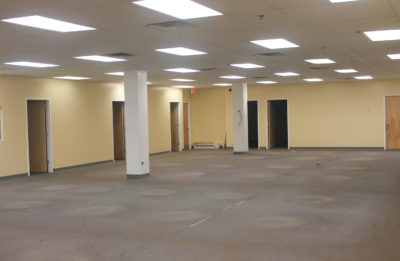 Empty flex space with office doors around it