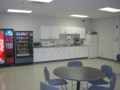 Photo of breakroom with counter and vending machines.
